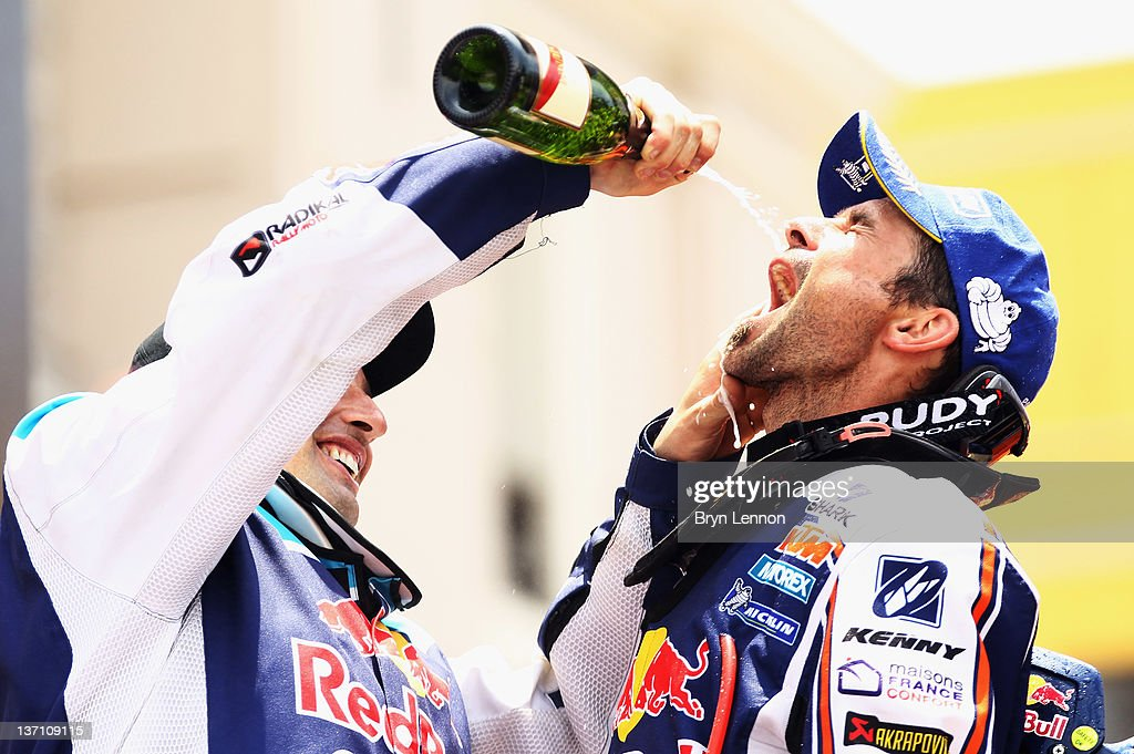 Cyril Despres of France and Team Red Bull KTM celebrates on the podium after winning the motorbike category of the 2012 Dakar Rally from Pisco to...