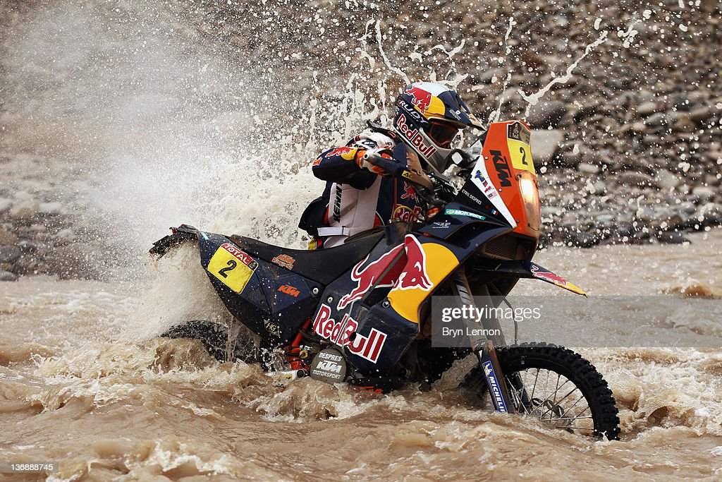 Cyril Despres of France and Team Red Bull KTM pushes his motorbike through a river during stage eleven of the 2012 Dakar Rally from Arica to Arequipa...