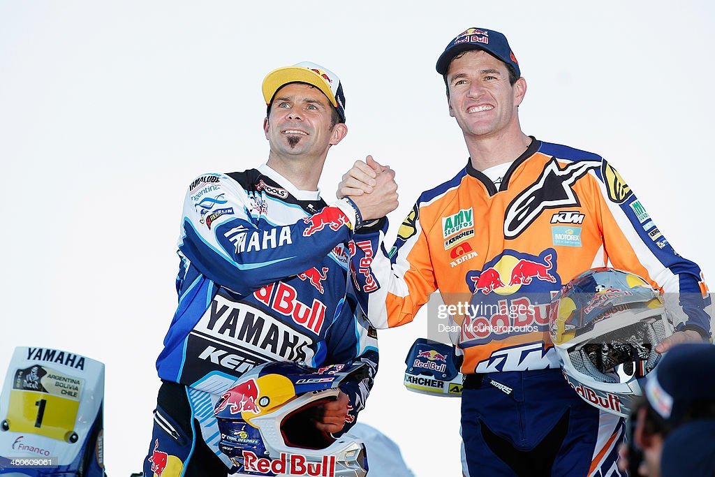 Cyril Despres of France for the Yamaha Factory Racing team and Marc Coma of Spain for the KTM Red Bull Rally Factory Team shake hands on the official...