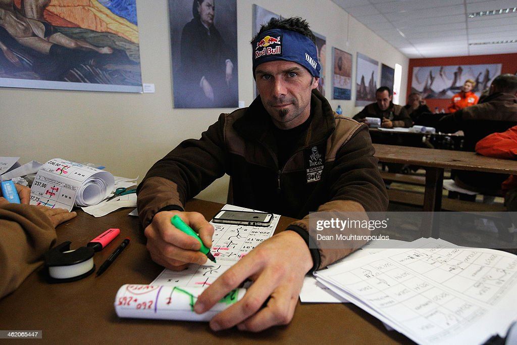Cyril Despres of France for the Yamaha Factory Racing team plans tomorrows route during Day 8 of the 2014 Dakar Rally on January 12 2014 in Uyuni...