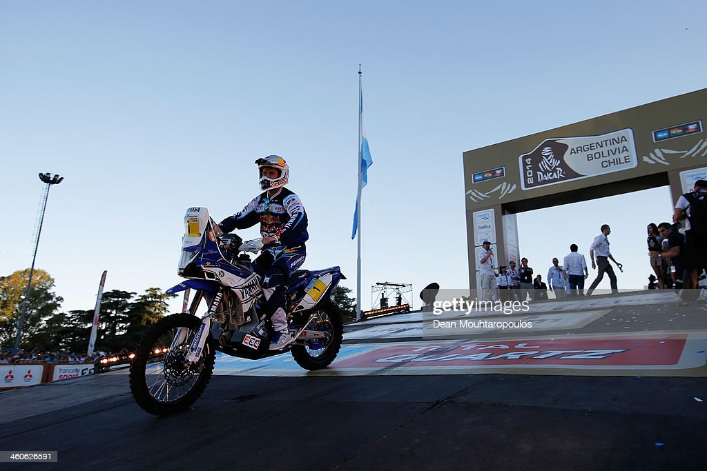 Cyril Despres of France for the Yamaha Factory Racing team rides off the official podium in front of The National Flag Memorial during the 2014 Dakar...
