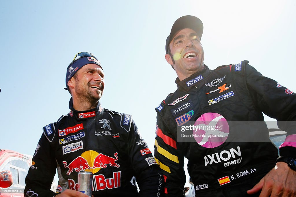 Cyril Despres of France in the PEUGEOT 2008 DKR for TEAM PEUGEOT TOTAL and Nani Roma of Spain in the MINI ALL4 RACING for AXION XRAID TEAM speak at...