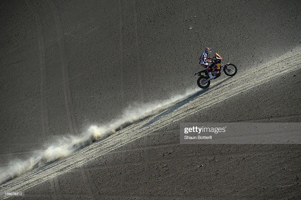 <a gi-track='captionPersonalityLinkClicked' href=/galleries/search?phrase=Cyril+Despres&family=editorial&specificpeople=2092881 ng-click='$event.stopPropagation()'>Cyril Despres</a> of KTM Red Bull Rally Factory Team competes in the stage from Pisco to Nazca on day three of the 2013 Dakar Rally on January 7, 2013 in Pisco, Peru.