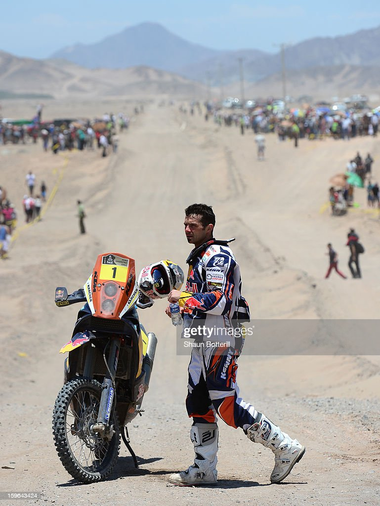Cyril Despres of KTM Red Bull Rally Factory Team feels the heat at the end of stage 12 from Fiambala to Copiapo during the 2013 Dakar Rally on January 17, 2013 in Fiambala, Argentina.