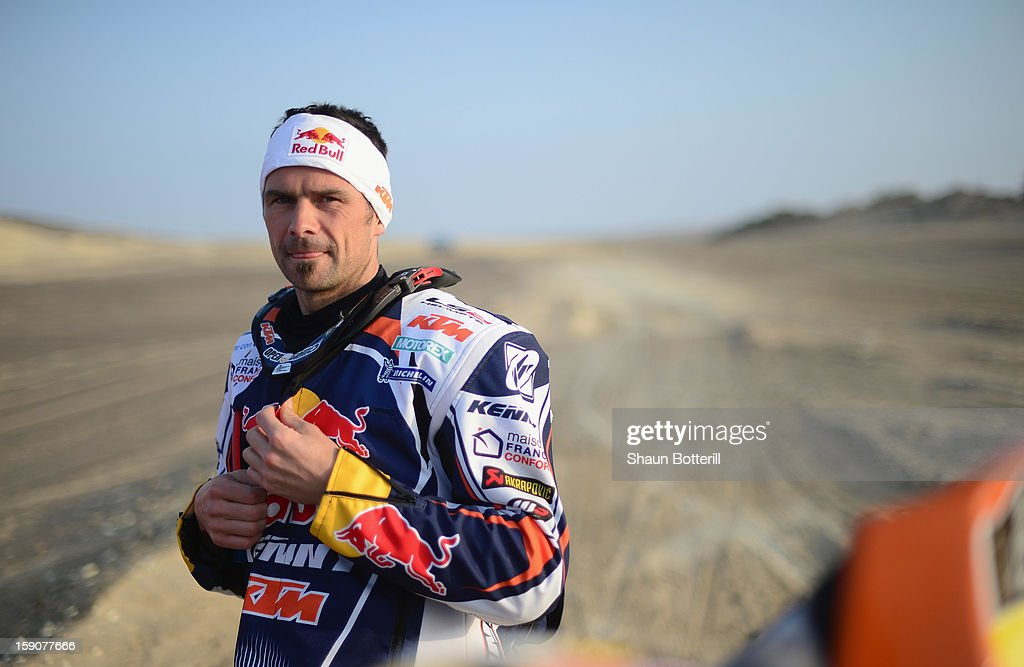 <a gi-track='captionPersonalityLinkClicked' href=/galleries/search?phrase=Cyril+Despres&family=editorial&specificpeople=2092881 ng-click='$event.stopPropagation()'>Cyril Despres</a> of KTM Red Bull Rally Factory Team waits at the start of the stage from Pisco to Nazca on day three of the 2013 Dakar Rally on January 7, 2013 in Pisco, Peru.