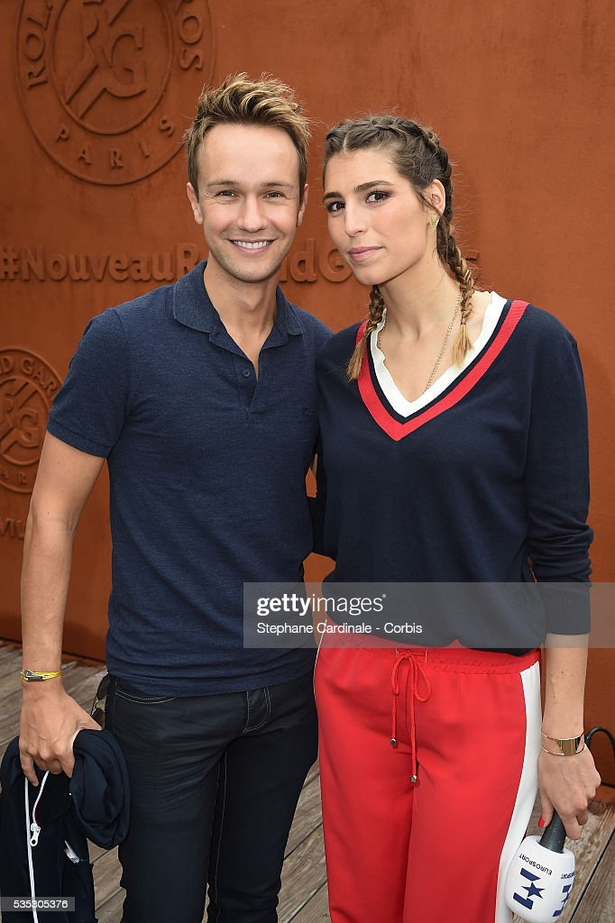 Cyril Feraud and Laurie Thilleman attend day eight of the 2016 French Open at Roland Garros on May 29, 2016 in Paris, France.