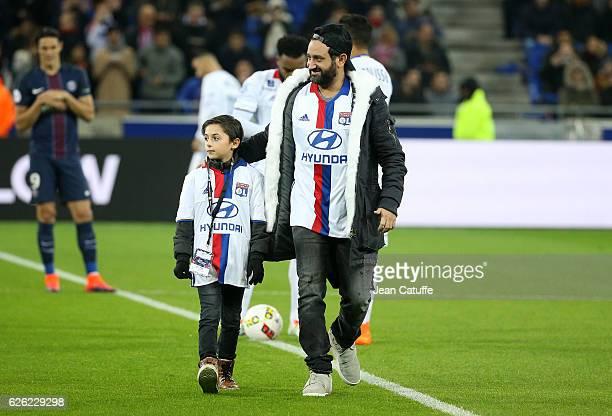 Cyril Hanouna and a young fan Hugo kicks off the French Ligue 1 match between Olympique Lyonnais and Paris SaintGermain at Parc OL stadium on...