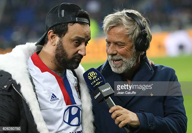 Cyril Hanouna is interviewed by Laurent Paganelli of Canal Plus after kicking off the French Ligue 1 match between Olympique Lyonnais and Paris...