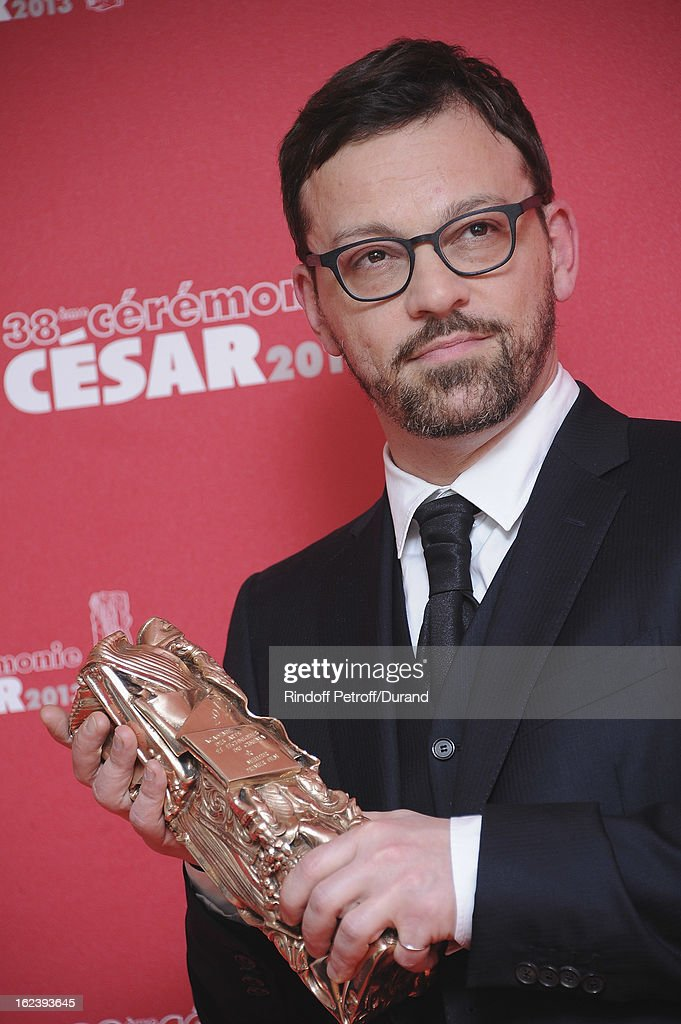 Cyril Mennegun poses with his trophy after receiving the Best Fisrt Movie award during the Cesar Film Awards 2013 at Theatre du Chatelet on February 22, 2013 in Paris, France.