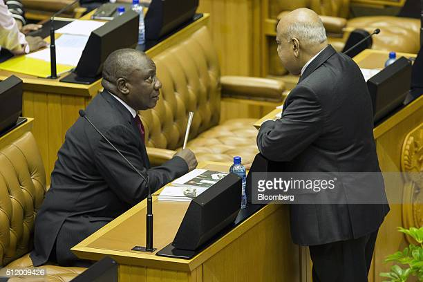 Cyril Ramaphosa South Africa's deputy president left speaks to Pravin Gordhan South Africa's finance minister before the presentation of the 2016...