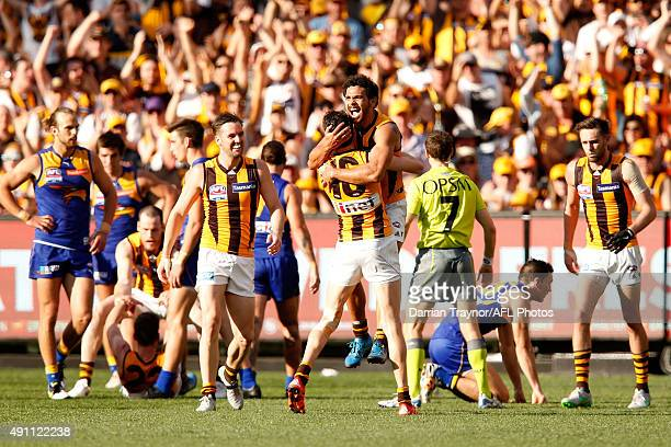 Cyril Rioli and Isaac Smith of the Hawks celebrate a goal during the 2015 AFL Grand Final match between the Hawthorn Hawks and the West Coast Eagles...