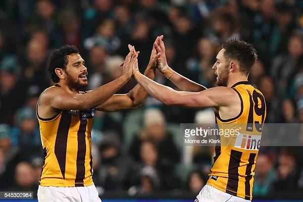 Cyril Rioli and Jack Gunston of the Hawks celebrate a goal during the round 16 AFL match between the Port Adelaide Power and the Hawthorn Hawks at...