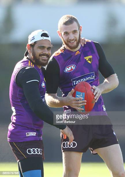 Cyril Rioli and Kurt Heatherley of the Hawks laugh during a Hawthorn Hawks AFL training session at Waverley Park on August 5 2016 in Melbourne...