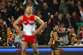 Cyril Rioli of the Hawks celebrates kicking a goal during the round 17 AFL match between the Sydney Swans and the Hawthorn Hawks at Sydney Cricket...
