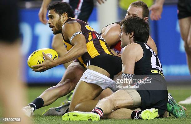 Cyril Rioli of the Hawks has his shorts pulled down in a tackled by Farren Ray of the Saints during the round 10 AFL match between the St Kilda...