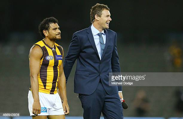 Cyril Rioli of the Hawks is approach by Cameron Mooney of Fox Footy for an interview after their win during the NAB Challenge AFL match between St...
