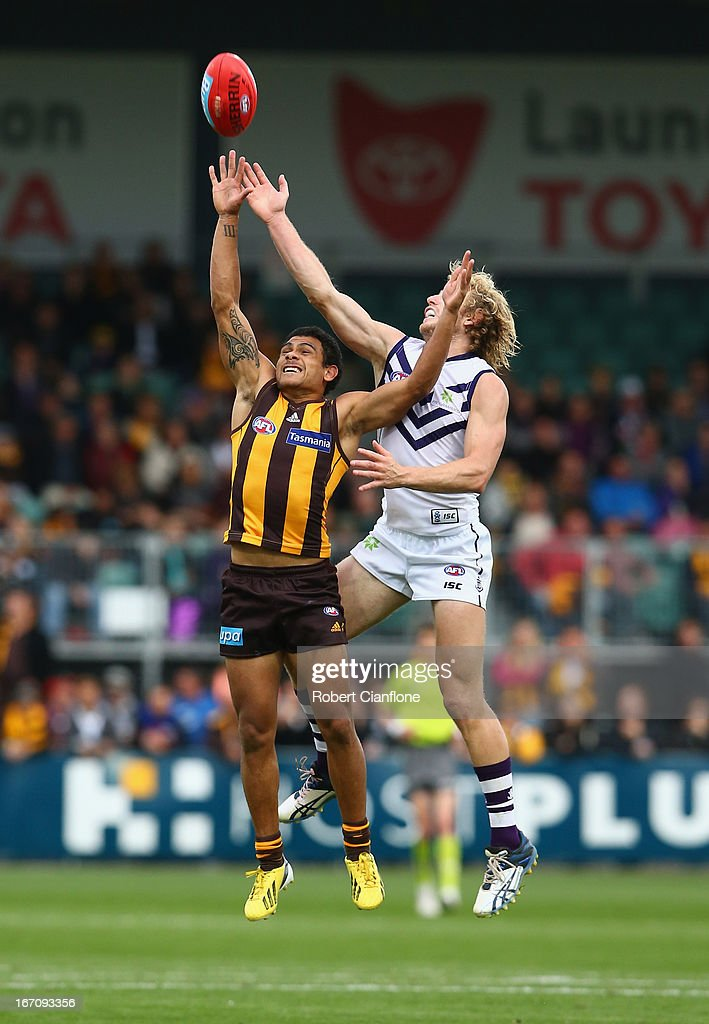 Cyril Rioli of the Hawks is challenged by David Mundy of the Dockers during the round four AFL match between the Hawthorn Hawks and the Fremantle Dockers at Aurora Stadium on April 20, 2013 in Launceston, Australia.