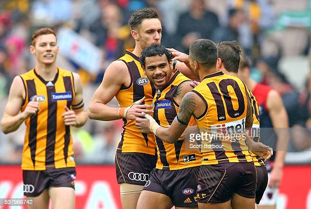 Cyril Rioli of the Hawks is congratulated by his teammates after kicking a goal during the round 11 AFL match between the Hawthorn Hawks and...