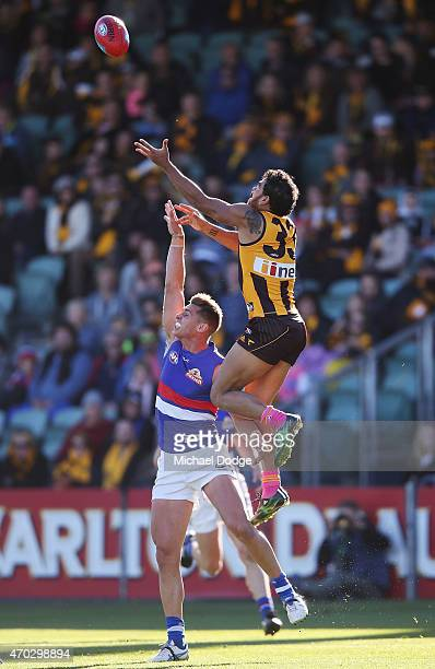 Cyril Rioli of the Hawks marks the ball over Michael Talia of the Bulldogs during the round three AFL match between the Hawthorn Hawks and the...