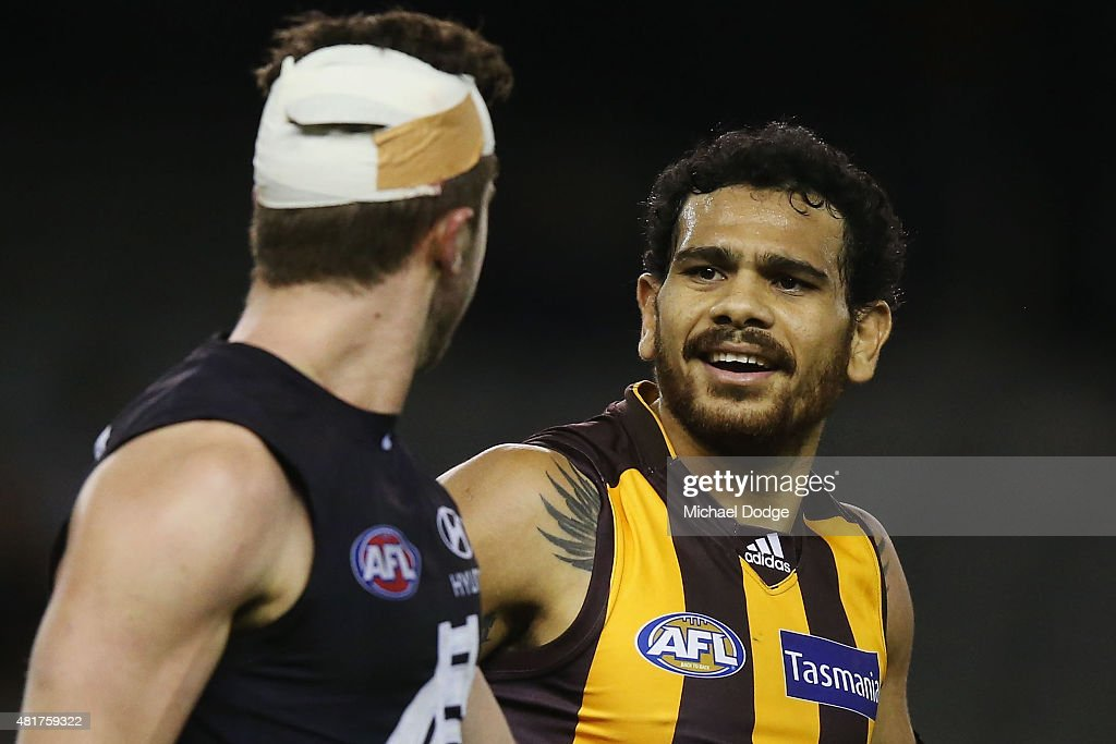 Cyril Rioli (R) of the Hawks reacts at Marc Murphy of the Blues after he laid a heavy tackle on him during the round 17 AFL match between the Carlton Blues and the Hawthorn Hawks at Etihad Stadium on July 24, 2015 in Melbourne, Australia.
