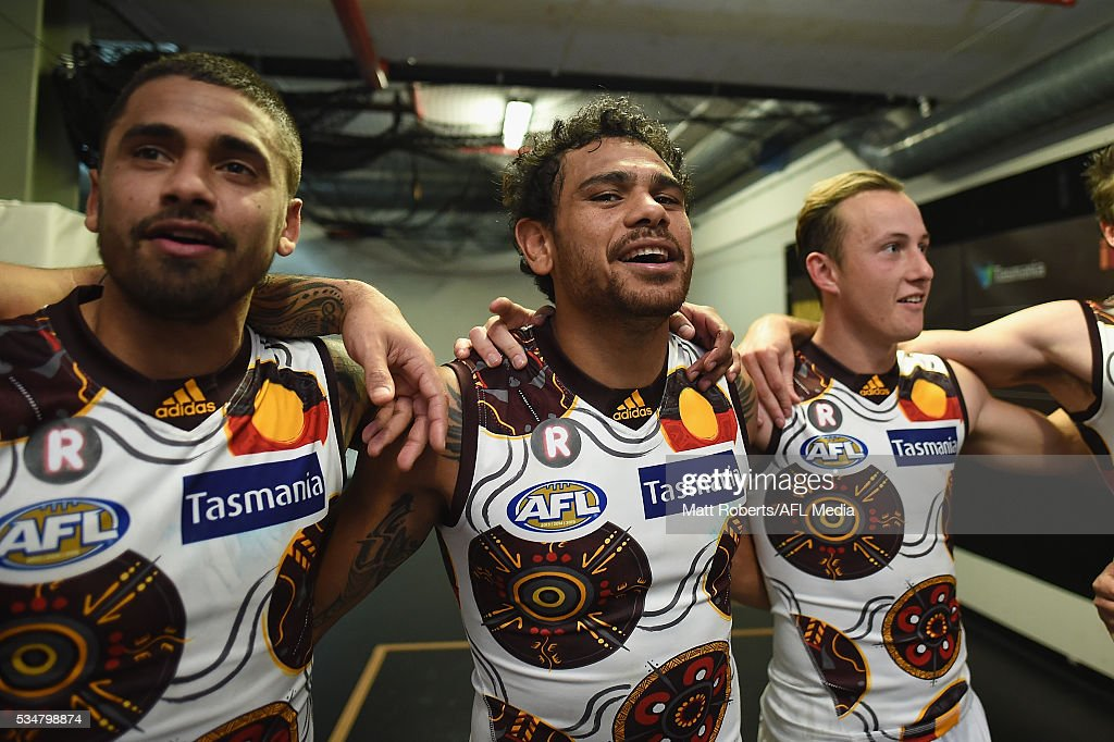 <a gi-track='captionPersonalityLinkClicked' href=/galleries/search?phrase=Cyril+Rioli&family=editorial&specificpeople=681811 ng-click='$event.stopPropagation()'>Cyril Rioli</a> of the Hawks sings the team song with team mates after the round 10 AFL match between the Brisbane Lions and the Hawthorn Hawks at The Gabba on May 28, 2016 in Brisbane, Australia.
