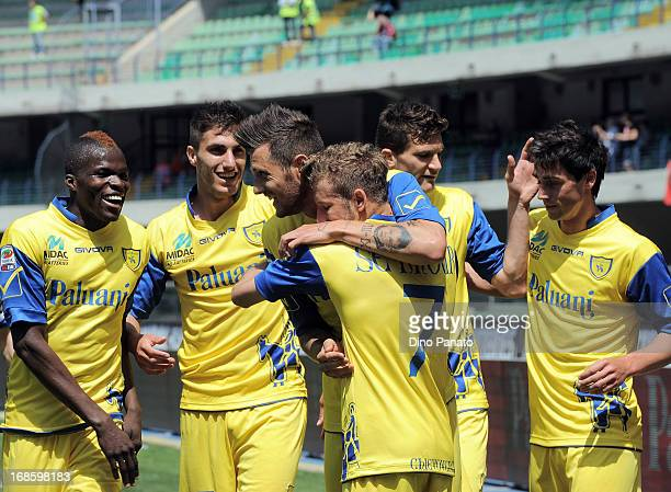 Cyril Thereau of AC Chievo is surrounded by teammates as they celebrate his opening goal during the Serie A match between AC Chievo Verona and Torino...