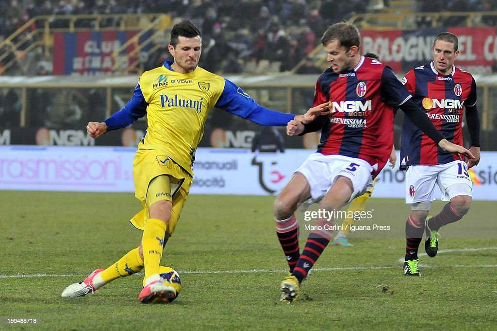 <a gi-track='captionPersonalityLinkClicked' href=/galleries/search?phrase=Cyril+Thereau&family=editorial&specificpeople=4063877 ng-click='$event.stopPropagation()'>Cyril Thereau</a> (L) of AC Chievo Verona competes for the ball with Michael Antonsson # 5 of Bologna FC during the Serie A match between Bologna FC and AC Chievo Verona at Stadio Renato Dall'Ara on January 12, 2013 in Bologna, Italy.