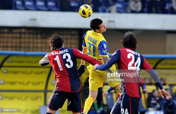Cyril Thereau of Chievo competes in the air with Kakha Kaladze of Genoa during the Serie A match between Chievo and Genoa at Stadio Marc'Antonio...
