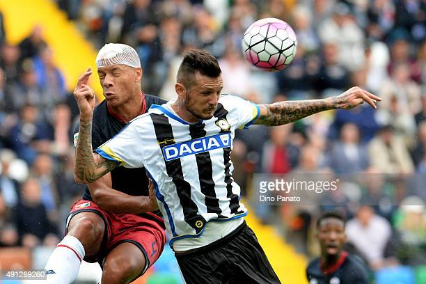 Cyril Thereau of Udinese Calcio battles for an aerial ball with Sebastian Demaio of Genoa CFC during the Serie A match between Udinese Calcio and...