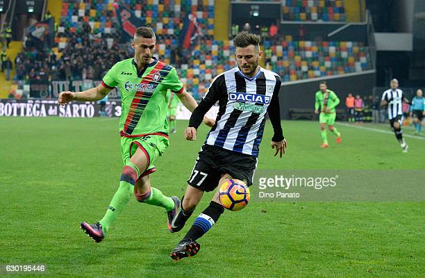 Cyril Thereau of Udinese Calcio competes with Aleandro Rosi of FC Crotone during the Serie A match between Udinese Calcio and FC Crotone at Stadio...