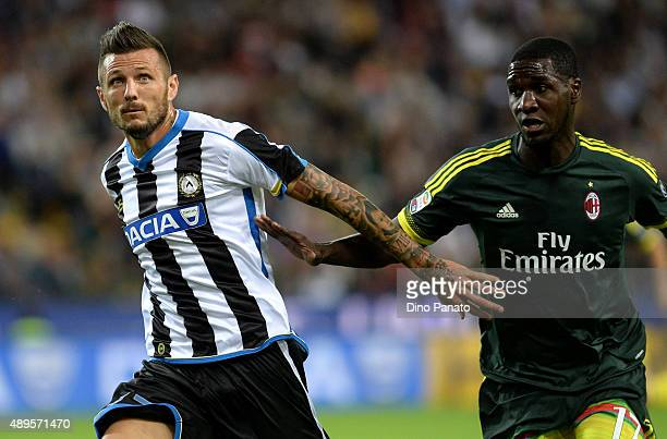 Cyril Thereau of Udinese Calcio competes with Cristian Zapata of AC Milan during the Serie A match between Udinese Calcio and AC Milan at Stadio...