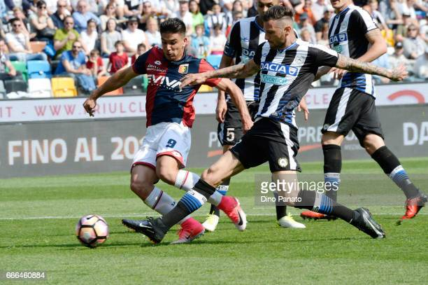 Cyril Thereau of Udinese Calcio competes with Giovanni Simeone Baldini of Genoa CFC during the Serie A match between Udinese Calcio and Genoa CFC at...