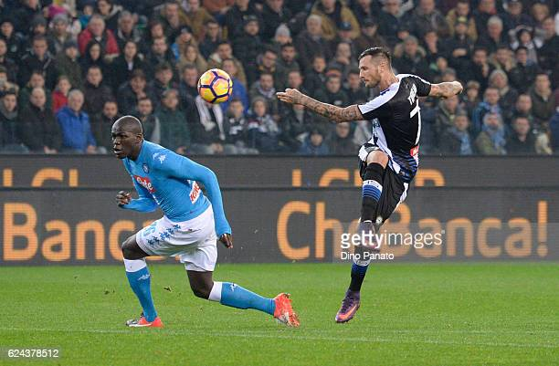 Cyril Thereau of Udinese Calcio competes with Kalido Koulibaly of SSC Napoli during the Serie A match between Udinese Calcio and SSC Napoli at Stadio...