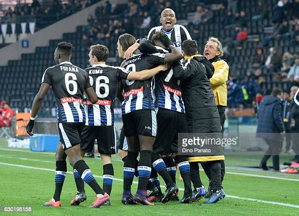 Cyril Thereau of Udinese Calcio is mobbed by team mates after scoring his team's second goal during the Serie A match between Udinese Calcio and FC...