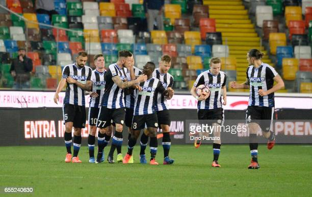 Cyril Thereau of Udinese Calcio is mobbed by team mates after scoring his team's first goal during the Serie A match between Udinese Calcio and US...
