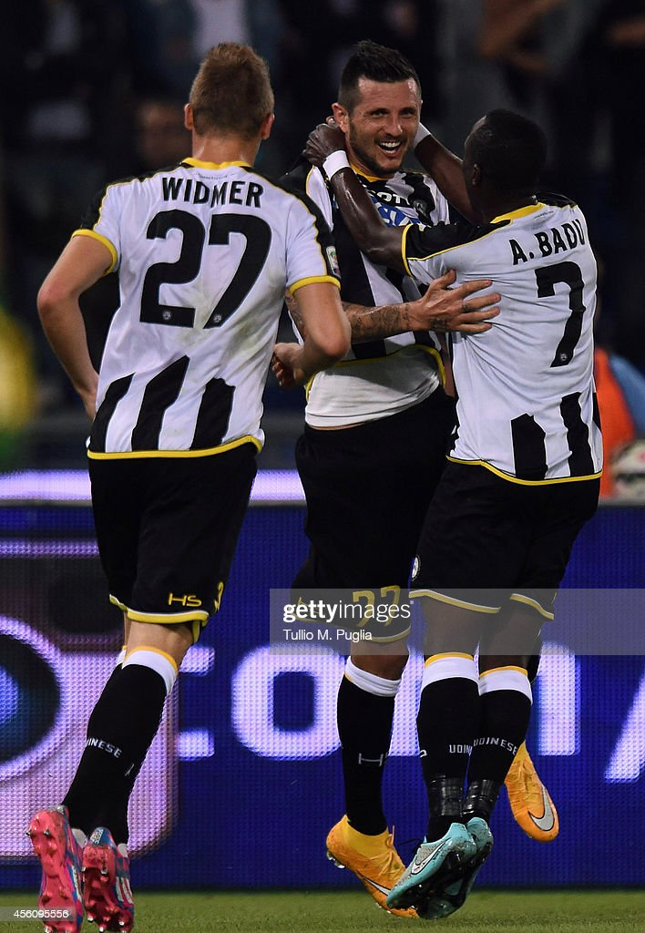 Cyril Thereau (C) of Udinese celebrates with team mates after scoring the opening goal during the Serie A match between SS Lazio and Udinese Calcio at Stadio Olimpico on September 25, 2014 in Rome, Italy.