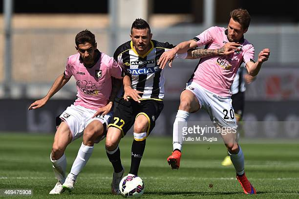 Cyril Thereau of Udinese is challenged by Ivajlo Chocev and Franco Vazquez during the Serie A match between Udinese Calcio and US Citta di Palermo at...