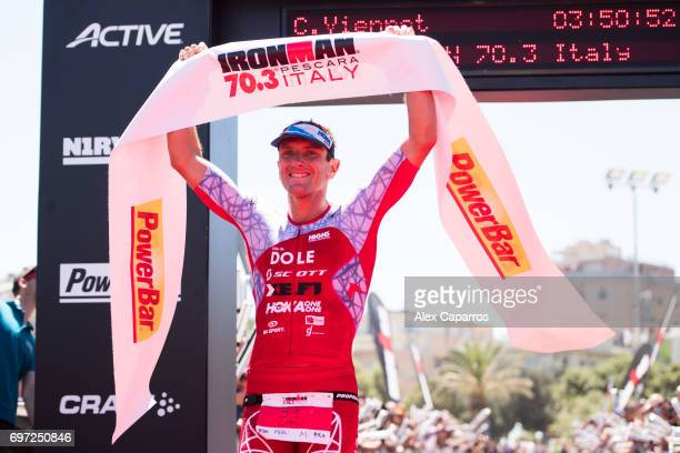 Cyril Viennot of France celebrates as he finishes in 1st position in the Ironman 703 Italy race on June 18 2017 in Pescara Italy