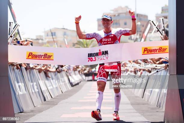 Cyril Viennot of France celebrates as he finishes in 1st position Ironman 703 Italy race on June 18 2017 in Pescara Italy