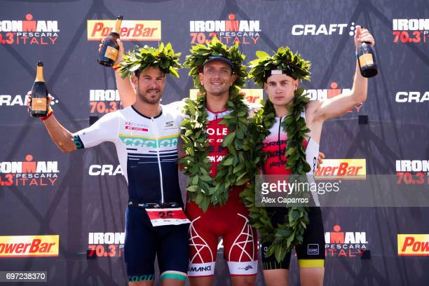 Cyril Viennot of France in 1st place Manuel Kung of Switzerland in 2nd place and Albert Moreno of Spain in 3rd place celebrate their positions after...
