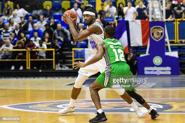 Cyrille Eliezer Vanerot of Levallois and Will Cummings of Darussafaka Dogus Istabul during the EuropCup match between Levallois Metropolitans and...
