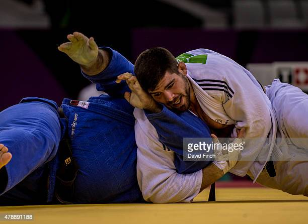 Cyrille Marat of France holds Adam Okruashvili of Georgia for an ippon to seal the gold medal for the French Men's team during day sixteen of the...