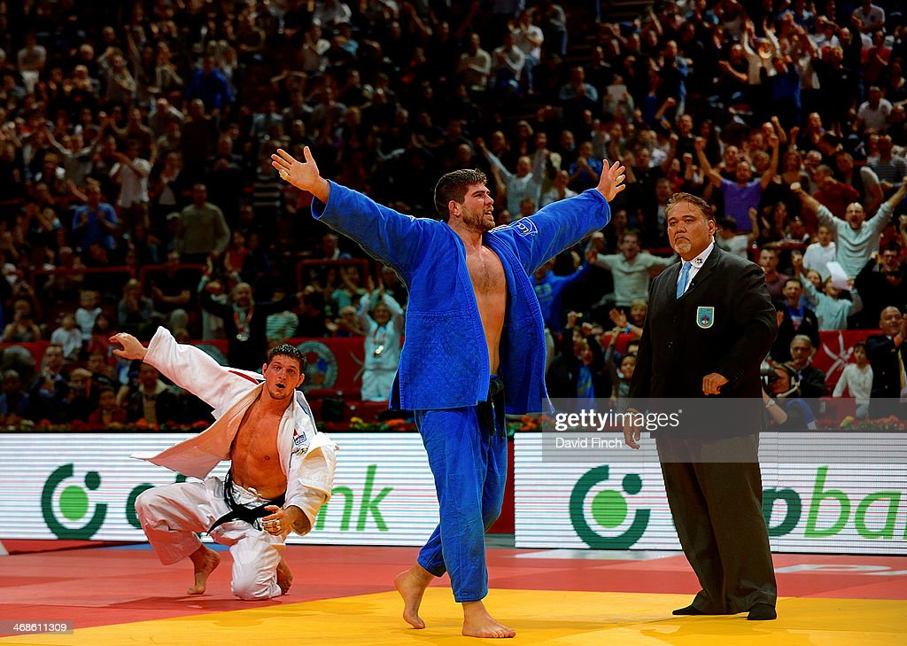 Cyrille Maret of France celebrates his gold medal victory over <a gi-track='captionPersonalityLinkClicked' href=/galleries/search?phrase=Lukas+Krpalek&family=editorial&specificpeople=6589582 ng-click='$event.stopPropagation()'>Lukas Krpalek</a> of the Czech Republic during the Paris Grand Slam on Sunday, February 09, 2014 at the Palais Omnisports de Paris, Bercy, Paris, France.