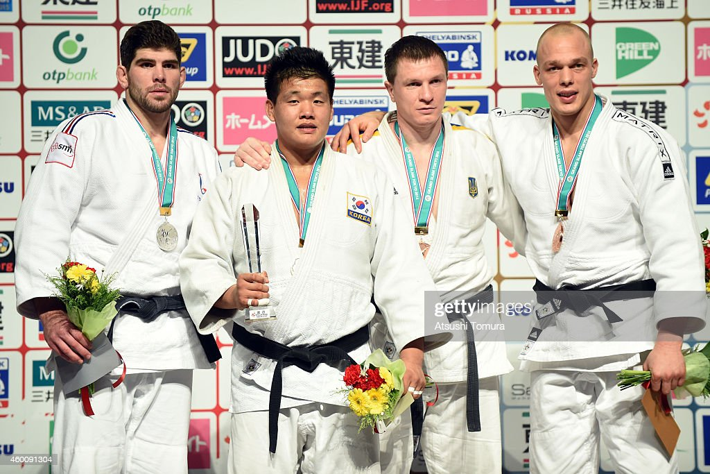 Cyrille Maret of France (Silver), Guham Cho of Korea (Gold), Artem Bloshenko of Ukrain (Bronze) and <a gi-track='captionPersonalityLinkClicked' href=/galleries/search?phrase=Henk+Grol&family=editorial&specificpeople=4920749 ng-click='$event.stopPropagation()'>Henk Grol</a> of Netherlands (Bronze) pose in the victory ceremony for Men's -100kg during Judo Grand Slam Tokyo 2014 at Tokyo Metropolitan Gymnasium on December 7, 2014 in Tokyo, Japan.