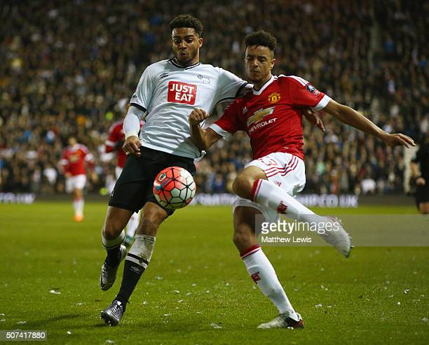 Cyrus Christie of Derby County and Cameron BorthwickJackson of Manchester United battle for the ball during the Emirates FA Cup fourth round match...