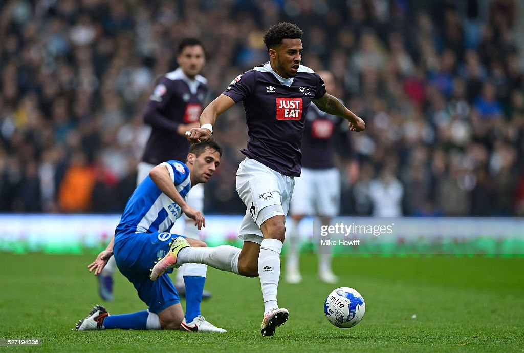 Cyrus Christie of Derby County goes past Sam Baldock of Brighton and Hove Albion during the Sky Bet Championship match between Brighton and Hove Albion and Derby County at the Amex Stadium on May 2, 2016 in Brighton, United Kingdom.