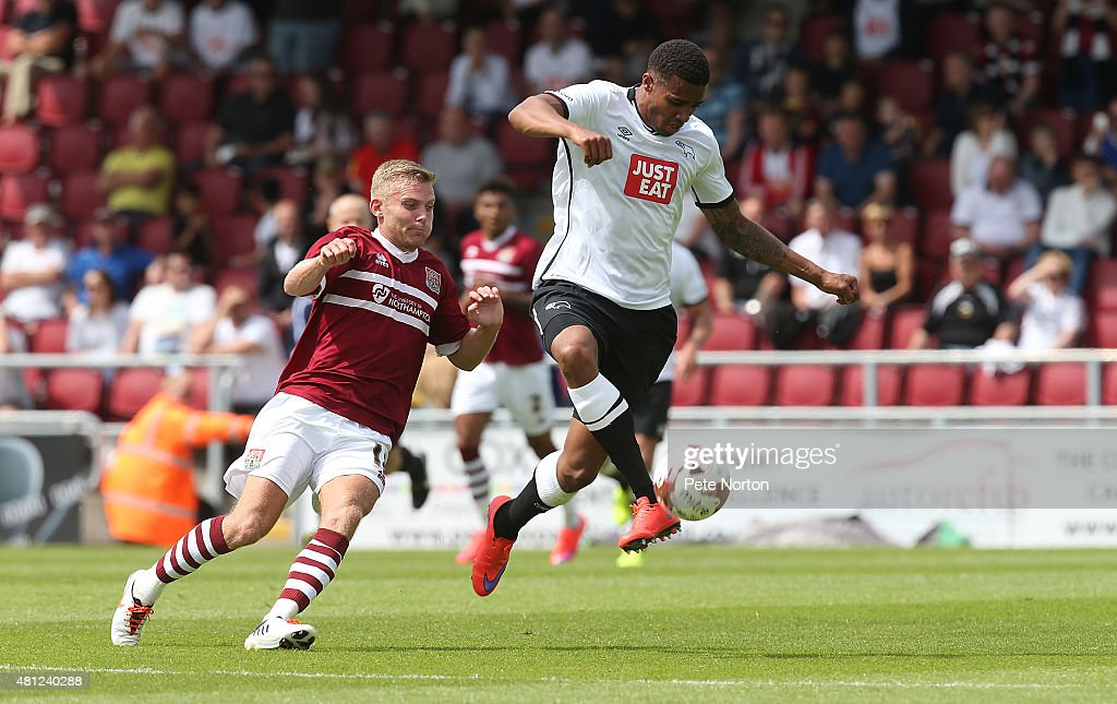 Cyrus Christie of Derby County looks to control the ball watched by Alfie Potter of Northampton Town during the Pre-Season Friendly match between Northampton Town and Derby County at Sixfields Stadium on July 18, 2015 in Northampton, England.