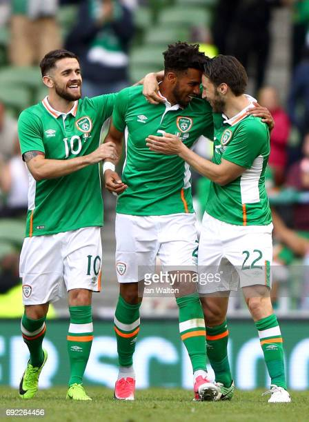 Cyrus Christie of the Republic of Ireland celebrates scoring his team's second goal with Robbie Brady and Harry Arter during the International...