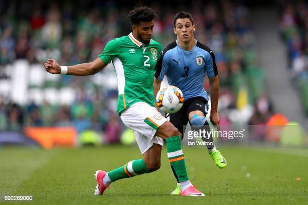 Cyrus Christie of the Republic of Ireland tackles Federico Ricca of Uruguay during the International Friendly match between Republic of Ireland and...