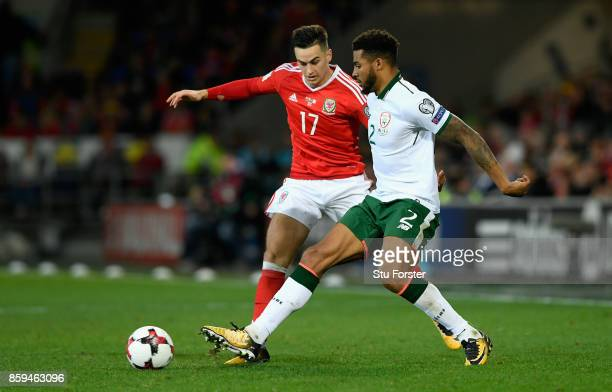 Cyrus Christie of the Republic of Ireland takes on Tom Lawrence of Wales during the FIFA 2018 World Cup Group D Qualifier between Wales and Republic...